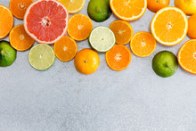 Mixed Still Life Border Of Fresh Cut Citrus Fruit