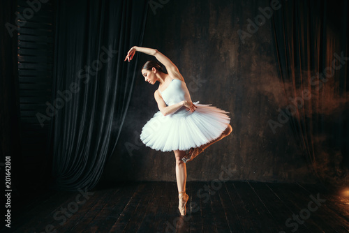 Graceful ballerina dancing on theatrical stage Tapéta, Fotótapéta