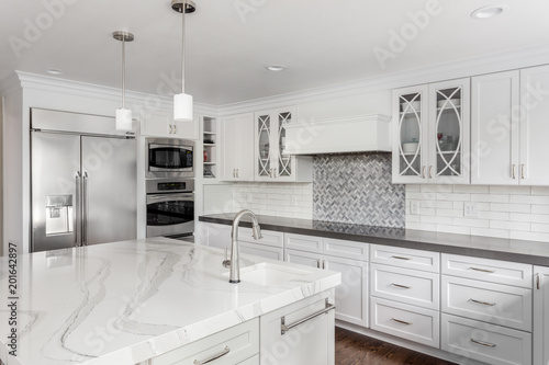 Kitchen In New Luxury Home With White Cabinets Stainless