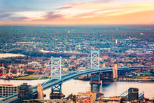 Aerial View Of Ben Franklin Bridge Spanning Delaware River, In Philadelphia