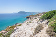 Beautiful sunny coast view to the greek mediterranean blue sea with crystal clear water and pure sandy beach empty place with some mountains rocks surrounded, Kos, Dodecanese Islands, Greece