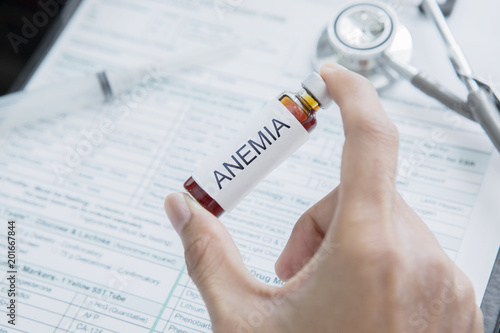 Male doctor hand holds drug for Anemia disease Wallpaper Mural