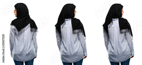 Carta da parati Arab woman wearing hijab backside, rear view isolated over white background