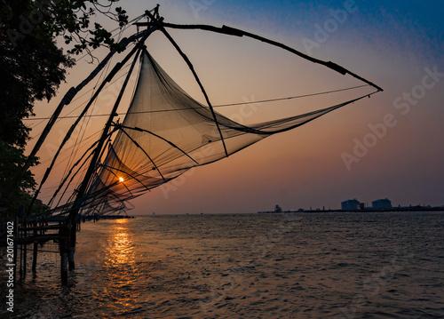 Staande foto Zeilen Fishing nets idle at sunset