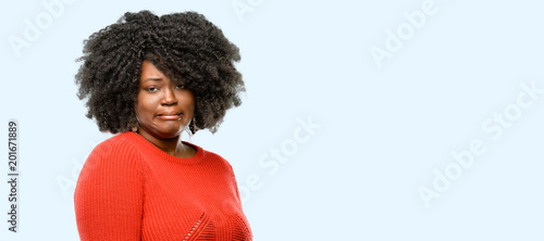 Fotografie, Tablou  Beautiful african woman feeling disgusted with tongue out, blue background