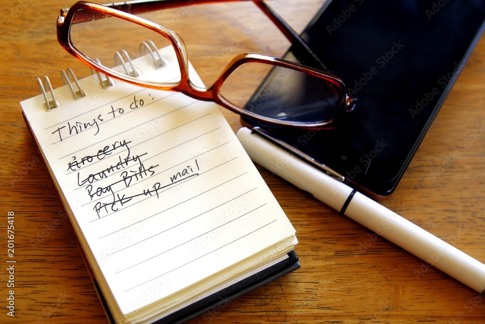 Fototapety, obrazy: Checklist on a notebook, pen, eyeglasses and smart phone