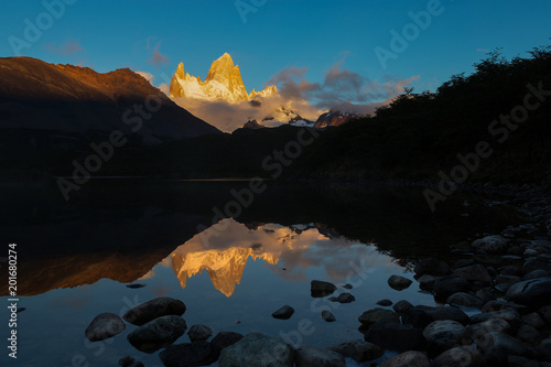 Alpenglow morning light of Mount Fitz Roy and its reflection on Laguna Capri, mountain in Patagonia, on border between Argentina and Chile Poster