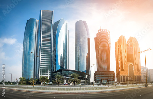 Poster Abou Dabi View of Abu Dhabi skyscrapers during sunset, United Arab Emirates