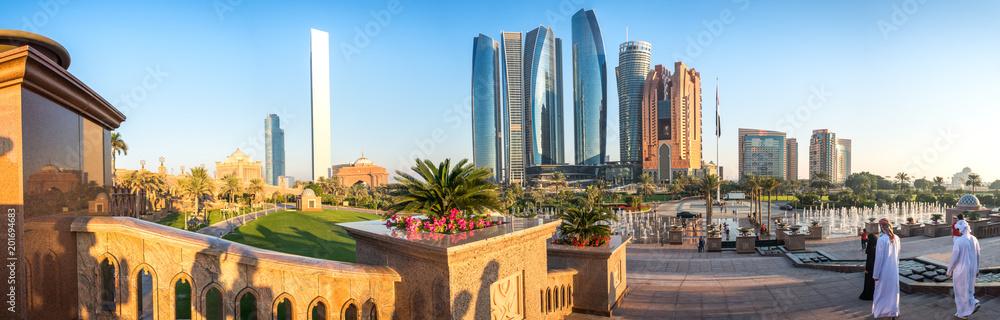 Fototapeta Panoramic view of Abu Dhabi Skyline at sunset, United Arab Emirates