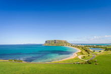 Stunning View Point To Big Old Volcanic Rock Mountain Top Called The Nut With Blue Turquoise Water Beach Bay And Green Grass Lands On Warm Sunny Clear Sky Day, Stanley, North-West, Tasmania, Australia