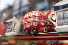A London Souvenir Shop Displaying British Souvenirs Including A Classic British Red Double Decker Bus Tea Pot Celebrating A Royal Wedding