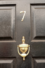 House Number 7 Sign On Black Door With Brass Door Knocker