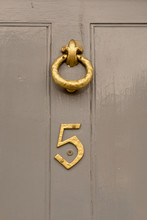 House Number 5 Sign On Green Door With Brass Door Knocker