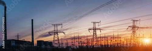 Fotografiet  Thermal power stations and power lines during sunset