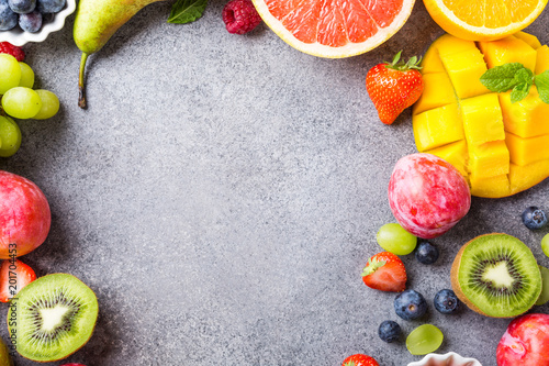Keuken foto achterwand Vruchten Overhead shoot with fresh assorted fruits and berries on light gray background. Colorful clean and healthy eating. Detox food. Copy space. Top view.