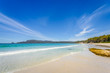 Amazing view to great paradise island sandy beach with turquoise blue water and green shore jungle forest on warm sunny clear sky relaxing day, River Adventure Bay, Bruny Island, Tasmania, Australia