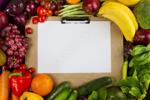 Clean fruits and vegetable with paper board put on middle frame, Diet program with clean healthy food concept Canvas Print