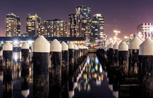 Docklands Pilings In Front Of Luxury Highrises In Melbourne, Australia