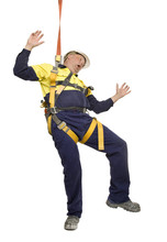 A Worker Wearing A Harness Tri...