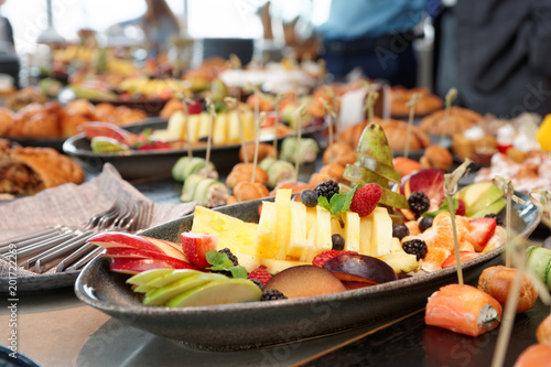 Foto op Aluminium Assortiment Cut fruits and another dishes