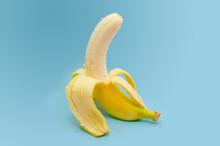 Fresh Peeled Banana On Blue Ba...