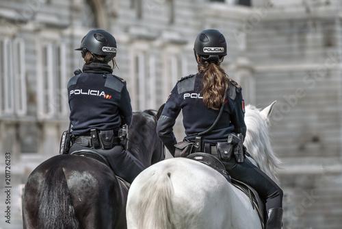Cuadros en Lienzo Two police women from Spain mounted on horseback.