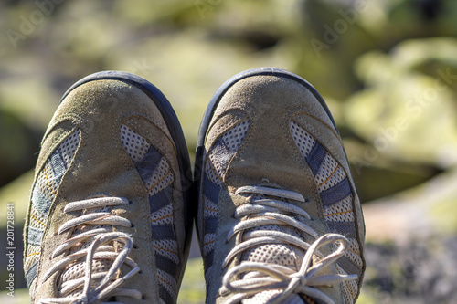 Close-up top view of pair of old worn comfortable men's classic white sneakers with gray inserts Canvas Print