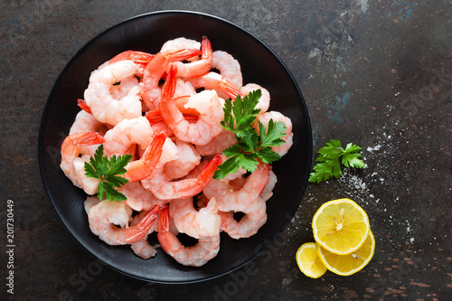 Prawns on plate. Shrimps, prawns. Seafood. Top view. Dark background