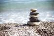 Zen stones on sea shore, symbol of buddhism