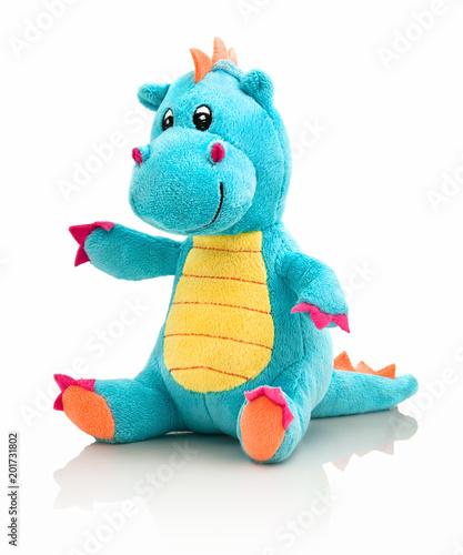 Dragon plushie doll isolated on white background with shadow reflection. Dragon plush stuffed puppet on white backdrop. Dino plushie toy. Aqua color stuffed dinosaur toy. Lizard toy sitting on white