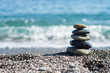 Zen stones on sea shore, symbol of buddhism