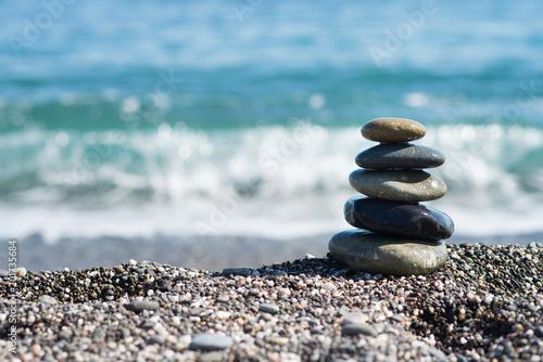 Foto op Canvas Zen Zen stones on sea shore, symbol of buddhism