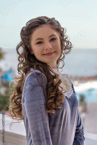 portrait of a smiling sly naughty girl with curlers in an old retro dress Poster Mural XXL