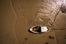 Aerial View Of An Abandoned Old Wooden Boat Near The Sea