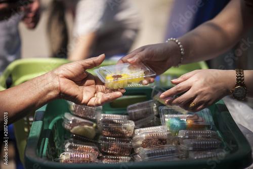 Valokuva  poverty concept feeding food for beggar