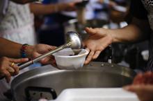 Poverty Concept Feeding Food F...