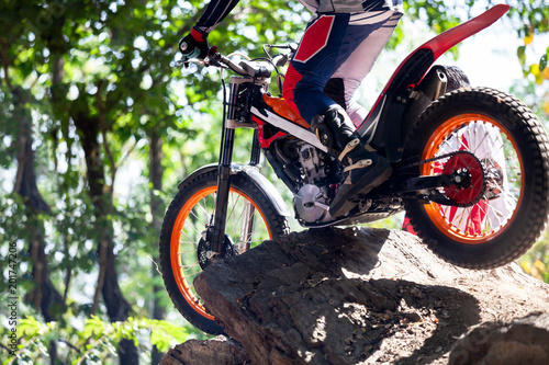 Trials motorcycle while competition in nature park, close up shot Fototapeta