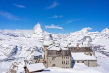 The Observatory On Gornergrat Summit Overlooking Matterhorn As Background In Zermatt, An Iconic Emblem Of The Swiss Alps In Canton Valais, Switzerland