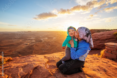 Stickers pour porte Orange eclat A mother and her baby son visit Canyonlands National park in Utah, USA
