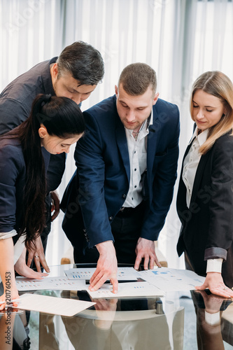 Fototapety, obrazy: business briefing. leadership. boss talking to his team in board room sharing information and giving instructions
