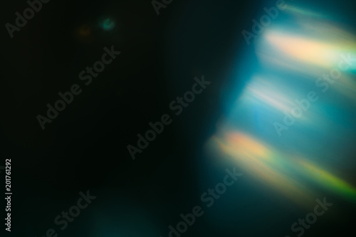 blurred defocused rays light. abstract lens flare. color burst. creative art. dark background