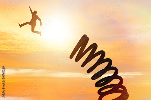 Businessman jumping from spring in promotion concept Fototapet