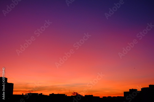 Foto op Canvas Candy roze Colorful gradient skyline during sunset in the city