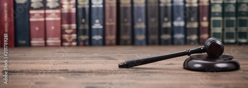 Judge Gavel and Law books on a  wooden background. Tapéta, Fotótapéta