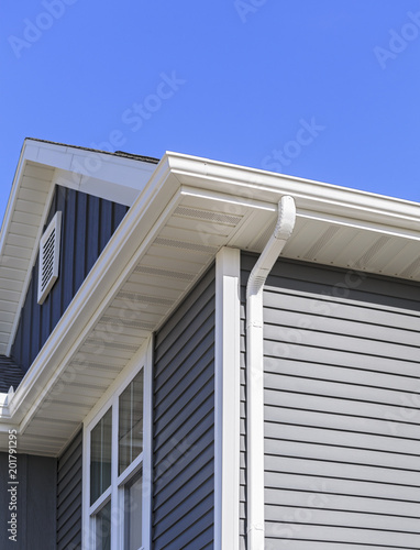 Valokuva  Grey siding, gutters, and soffit on a new home