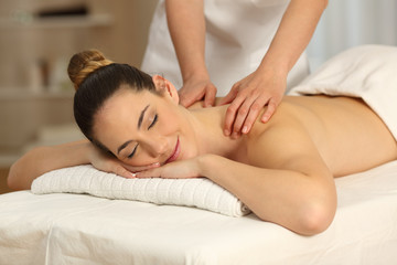 Relaxed woman receiving massage in a salon