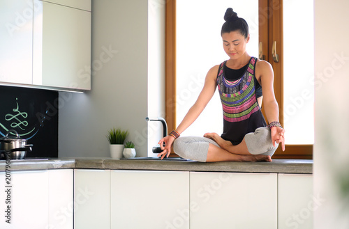 Fit and attractive young woman preparing healthy meal. Woman. Fototapet
