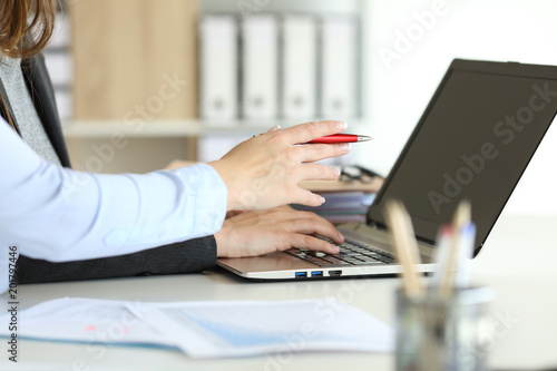 Executive hands working online with a laptop at office