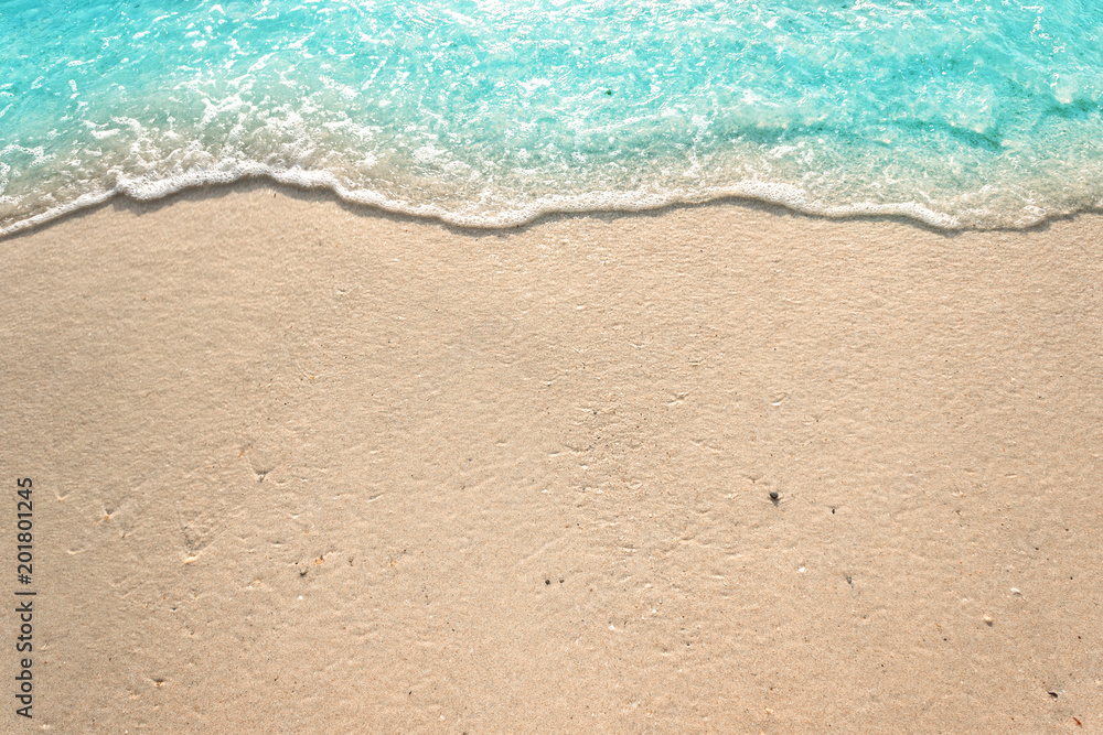Fototapety, obrazy: Soft waves with foam of blue ocean on the sandy beach