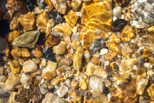 Colorful Pebbles Under Water S...